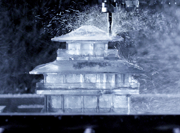 Finishing touches are applied to the temple shaped ice